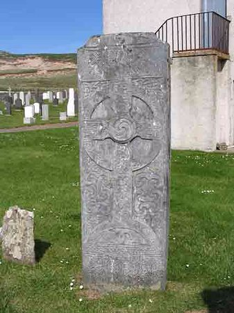 Bettyhill, UK: The Farr Stone at the west gable of the Strathnaver Museum
