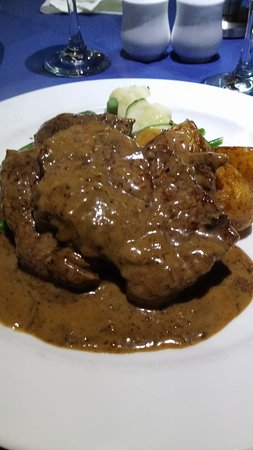 George's Paragon Seafood Restaurant Mt. Tamborine: My veal funghi. like it but dont think its the real veal.Loved the sauce I wiped the plate