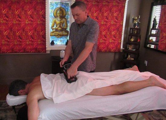 Finishing massage with mechanical vibration at Cool River Massage, Port Richey FL