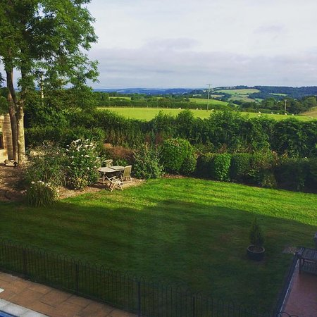 Rousdon, UK: View from the bedroom across the pool and gardens to the hills beyond