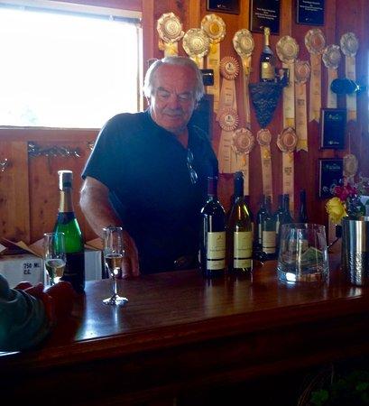 Point Reyes Vineyard Inn: Owner Steve at the Tasting Bar; Note Awards in Background