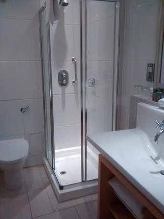 Small Bathrooms London small bathroom, phone box shower. - picture of hilton london green
