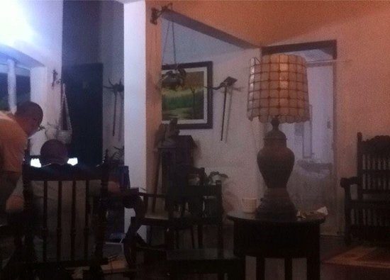 Riberalta, Bolivia: Late night in the open-air living, family area of the hotel, also used by many as work area