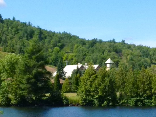 View of the hotel from 9 hole par 3 golf area,across the street, standing on dock on Calabogie L