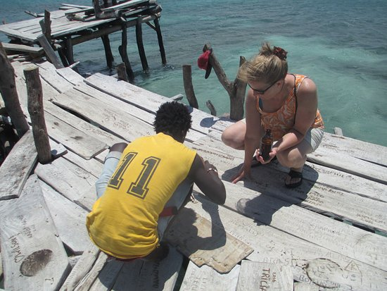 Floyd's Pelican Bar : For a small donation they'll carve your name in the floor.