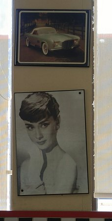 Angel's Diner : Audrey Hepburn's classic Hollywood portrait smiles at you! A cute Roadster from the '50s above h