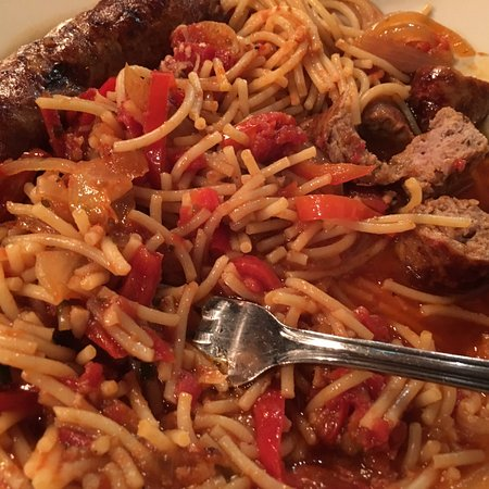 Gianmarco's: Sausage and peppers over spaghetti. Killer.