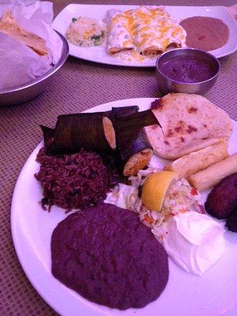 Gloria's Latin Cuisine: Gloria's Super Special (front) and Sour Cream Enchiladas (background)