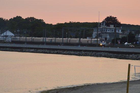 East Lyme, CT: Train rolling along beside boardwalk