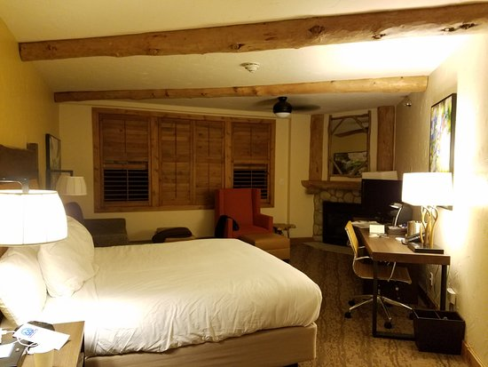 The Lodge at Breckenridge: King bed with sitting area in front of windows and a corner fireplace
