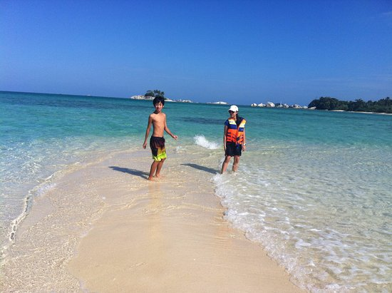 Tanjung Tinggi Beach: crystal clear water at tiny sand island, first stop on islands hopping tour