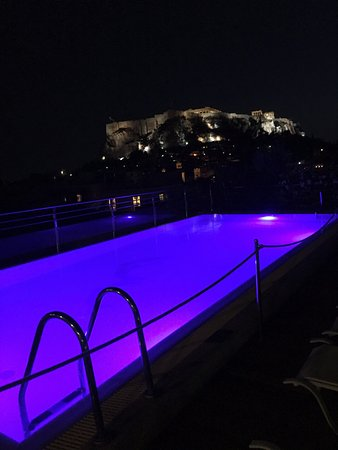 Electra Palace Athens: roof top pool at night looking towards the acropolis