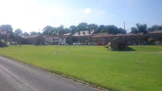 Fox & Hounds Inn: View from across the green to the pub