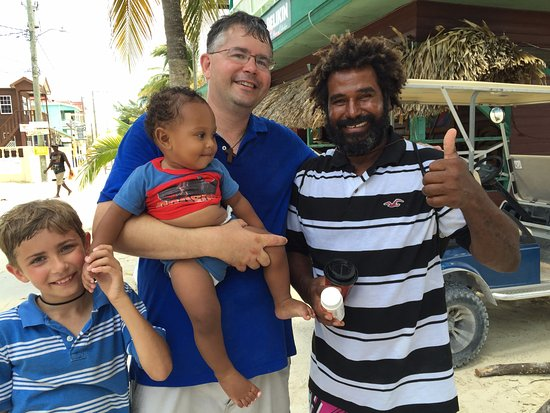 Caye Caulker, Belize: Myself with Mr. Caveman, his son, and my son!