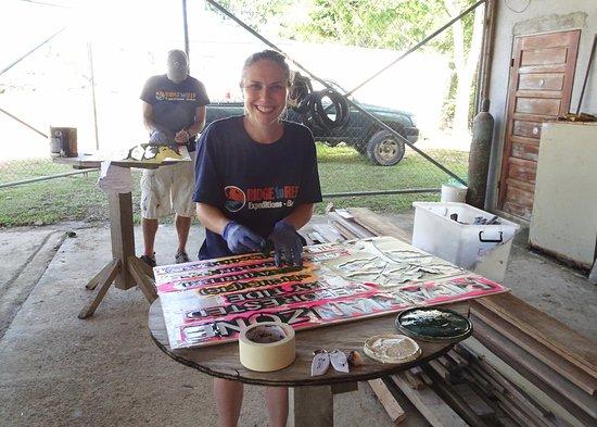 Punta Gorda, Belize : Painting reforestation signs at TIDE head quarters