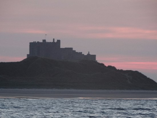 Cheswick, UK: A view of Bamburgh Castle from out at sea
