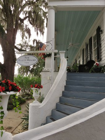The Rhett House Inn: Front porch stairs leading to front door and snacks/breakfast on porch (or, inside the Inn)