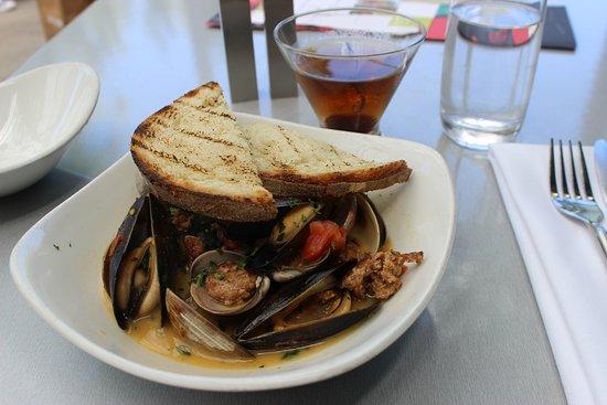 Penn Cove Mussels and Manila Clams Fire roasted tomato, garlic, sherry, oregano, spanish chorizo