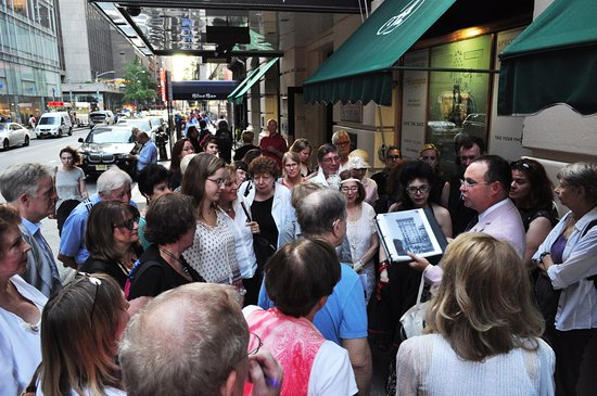 Big Apple Fanatics Tours: Kevin showing the tour group reference materials,  which always helps