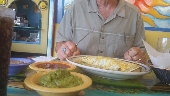 At LA Brisa. Great food. Excellent pork burrito in Verde sauce. Beautiful art