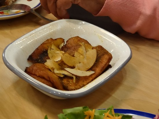 Camberley, UK : A bowl of Plantain chips with coconut flakes.