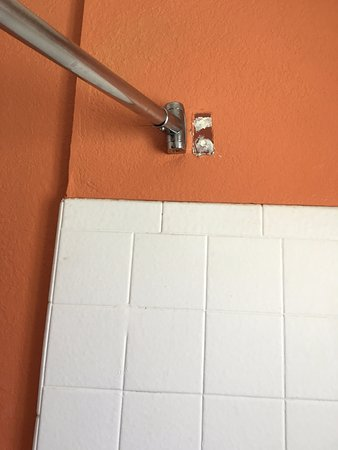 Buttonwillow, CA: shower curtain rod was reinstalled but holes werent repaired