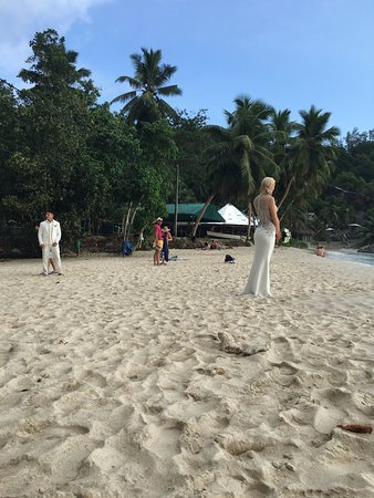 Chez Batista Villas: People come to this beach just for wedding pictures! With a beautiful sunset
