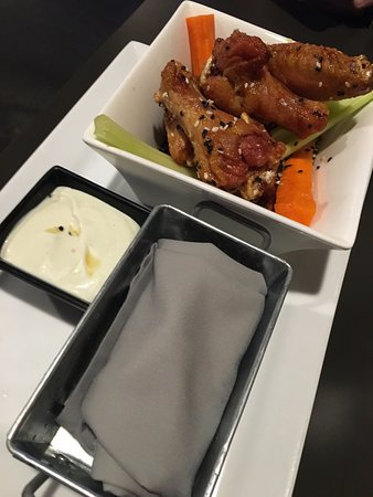 Post Falls, ID: Sesame ginger wings with wasabi dressing, and a warm cloth to wipe sticky fingers :)