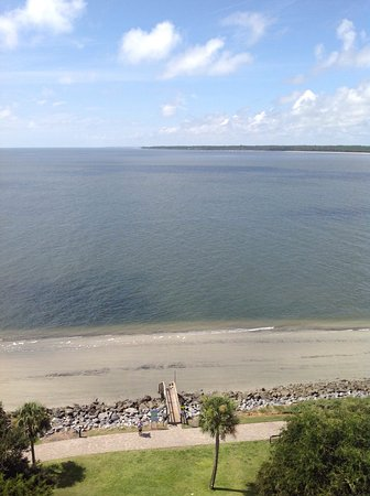 The Beachfront At Low Tide The Clear Blue Of The Ocean Picture