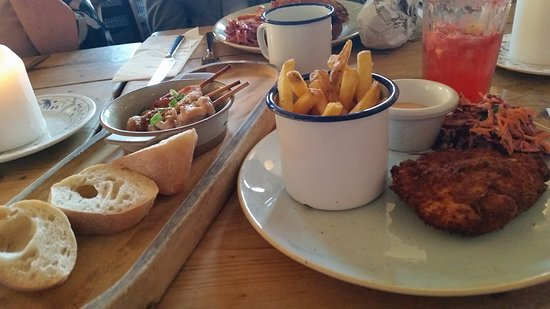 Tapas of chicken on skewer in tasty sauce plus chicken and chips as main with coleslaw and mayon