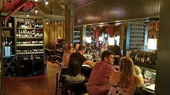 Iron Bridge Wine Company: This is the Iron Bridge Wine Bar and tasting room. They have some small tables croweded in this