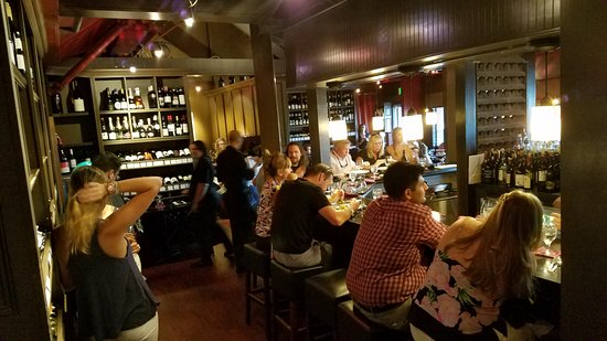 Iron Bridge Wine Company: This is the Iron Bridge Wine Bar. See ladies standing on left.  Just no place to waite for a tab
