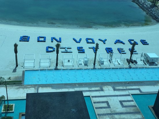 Fairmont Bab Al Bahr: Neat bon voyage message (written with lounging beach chairs) to a group departing the resort .
