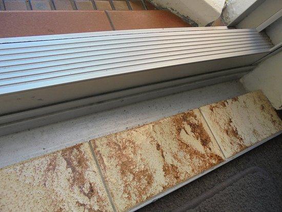 Grosvenor Beachfront Apartments sant/grit in door ledge prevented door from opening properly & sant/grit in door ledge prevented door from opening properly ...