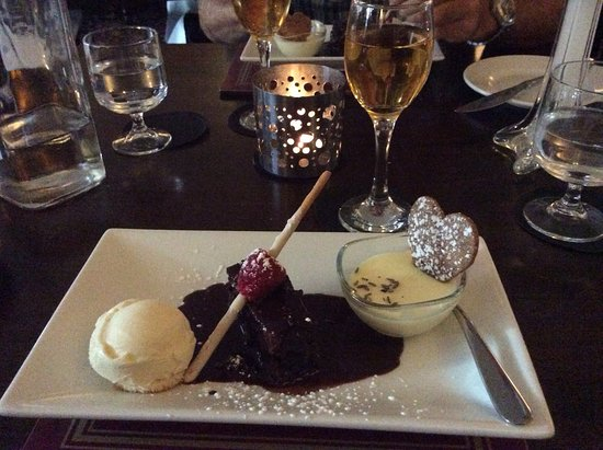 Wark, UK: Chocolate cake, ice cream, lemon posset with lavender and ginger biscuit
