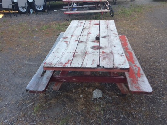 "Yellowstone Cabins and RV Park: This rotten picnic table is the only thing ""rustic"" about this rv spot."