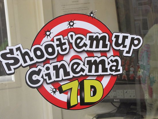 Shoot'em Up Cinema: The sign at the ticket booth.