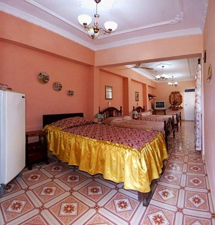 very big room with three beds , perfect for a family