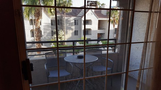 Holiday Inn Club Vacations Las Vegas - Desert Club Resort: There is a small balcony with 2 chairs and a small table.