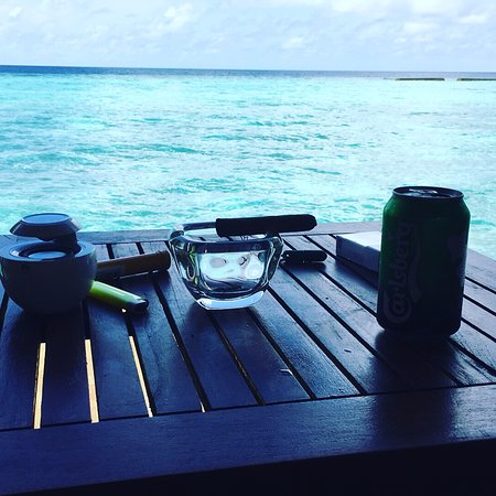 Veligandu Island Resort & Spa: My coffe and cigar spot every day from my room :-)