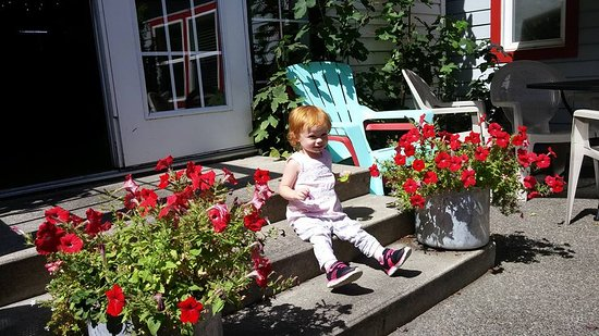 Sandpoint, ID: This is our granddaughter enjoying the gorgeous flowers in the entry to outside area