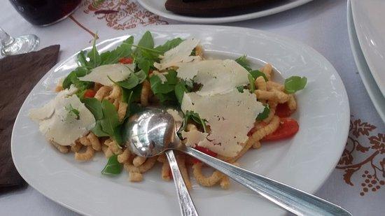 Roncofreddo, Italy: passatelli assciutti pomodorini rucola e grana