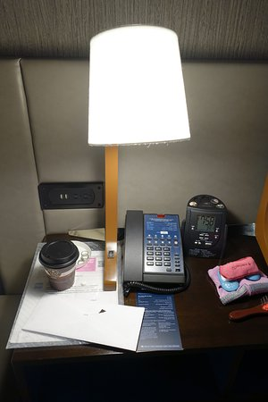 Hilton Chicago/Magnificent Mile Suites: Nightstand with outlets - even USB, in Alcove two doubles-corner suite on the 16th floor