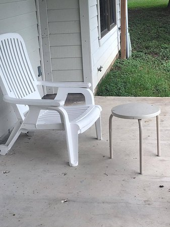 Montgomery, TX: The single lawnchair and table on back porch of cottage.