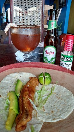 Poneloya, Nicaragua: Fish filet, Mexico D.F. style with a refreshing michelada.