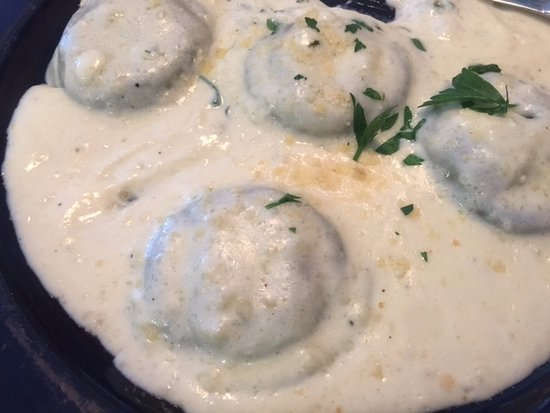 Georgetown, DE: Spinach Ravioli in a light cream sauce - generous serving & enough to share.