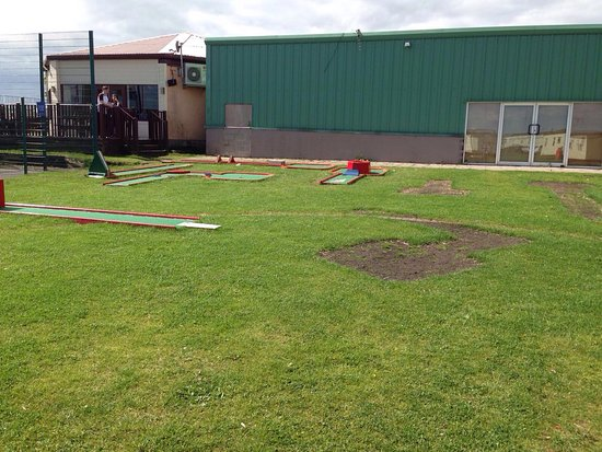 Ashington, UK: This is the appalling crazy golf at Sandy Bay. As you can see half of it is missing and the felt