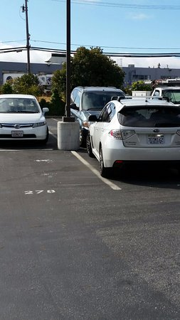 Millbrae, CA: You have inconsiderate driver who took up 2 spaces.