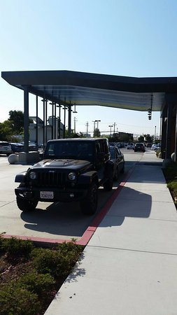 Millbrae, CA: Another view of the front entrance with illegally parked cars.