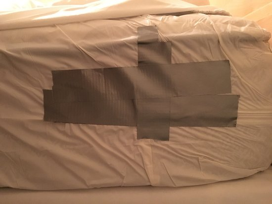 James Gettys Hotel: The tape on the plastic mattress cover so it can't be taken off.  Do the rooms rent by the hour?